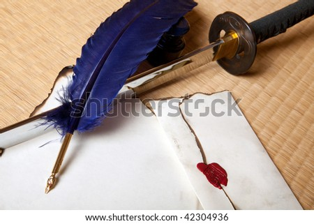 Vintage quill with japanese sword and parchment letter