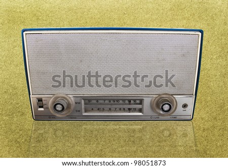 Vintage radio on grundge background