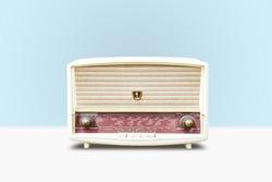 Vintage radio on pastel blue background