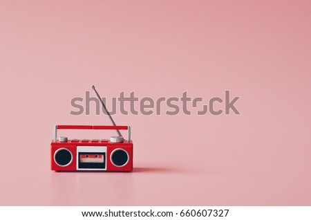 vintage radio on pink color background,copy space