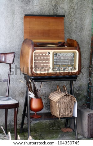 Vintage Radio Turntable cabinet  in a shabby  home interior