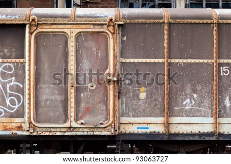 Vintage railroad container doors with more rusty old and pale color.