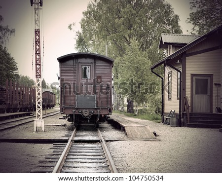 Vintage railway station with wooden car in small town