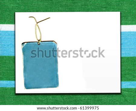 Vintage Real Tag On Striped Fabric With White Board Copy Space - stock photo