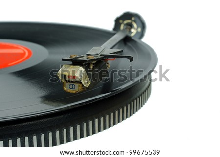 Vintage record player. Needle head and disc