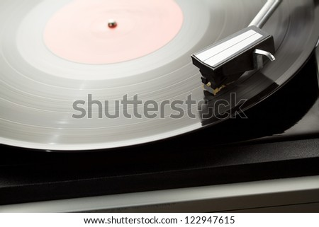 Vintage record player with spinning vinyl.