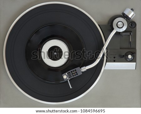 Vintage record player with vinyl record.  #1084596695
