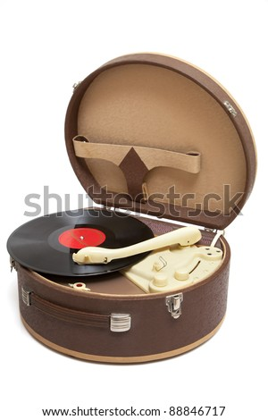 Vintage record player with vinyl record isolated on a white