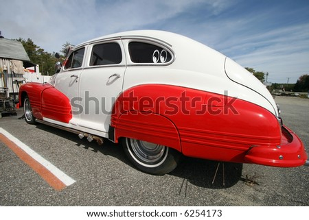 vintage red and white car