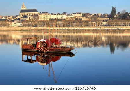 Vintage red boat in Blois water  . Valley of Loire , France