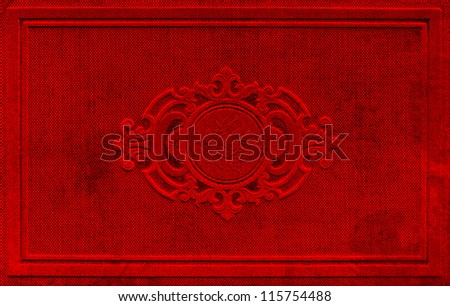 vintage red book cover with floral ornament. textured background