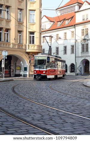 Vintage red cable car on narrow street in Prague,Czech Republic