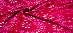 vintage red fabric with pale floral pattern useful for textures and backgrounds. Perfect for designs, your projects and more. Background texture