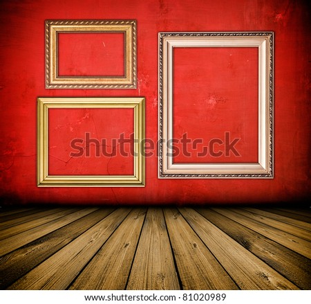 vintage red interior with empty frame hanging on the wall