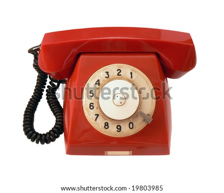 Vintage red phone on white background