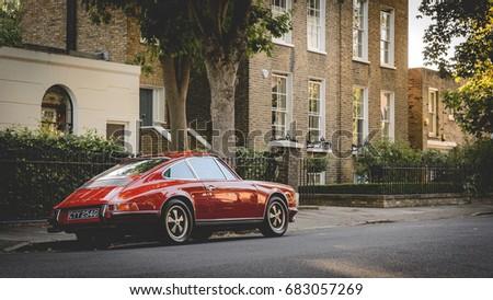vintage red porsche parked in a ...