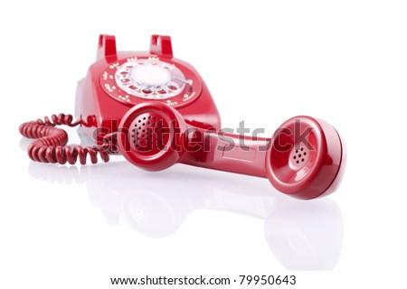 Vintage red rotary phone (with clipping path).A 1950-s Western Electric 500 model rotary telephone isolated on white.