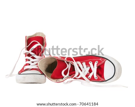 Vintage red shoes fallen on pure white background