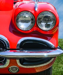 Vintage Red Sports Car front view, headlights and bumper detail