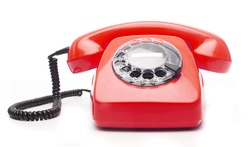 vintage red telephone isolated over white background