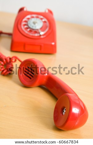 Vintage red telephone on wooden table