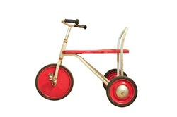 Vintage red tricycle isolated on white