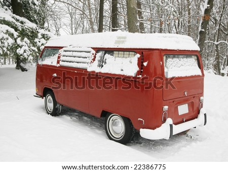 vintage red volkswagen bus in snow - stock photo