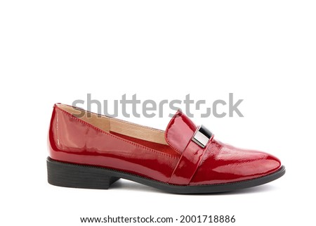 Vintage red Women's Loafer Shoes with metal accessories. Closeup. Advertising shot. Leather shoes. Concept closeup shoes. Isolated object close up on white background. Right shoe view. Stock fotó ©