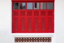 Vintage red wooden windows on the white wall