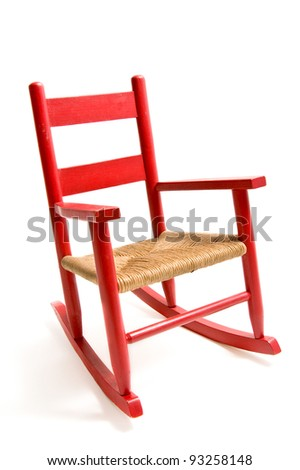 Vintage refurbished wooden child's rocking chair isolated on white