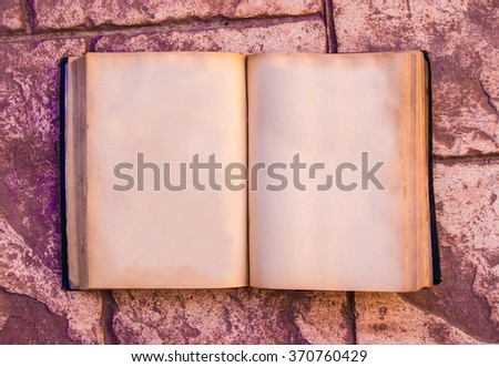 Vintage retro book mock up, open, on old brick table, with clipping path, empty space, blank paper