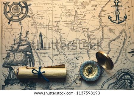 vintage retro compass on a treasure map concept #1137598193