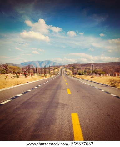 Vintage retro effect filtered hipster style image of travel forward concept background -  road in desert