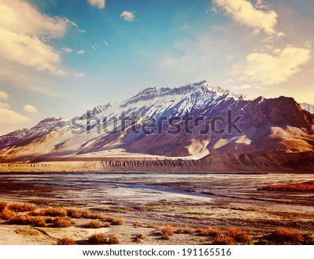 Vintage retro effect filtered hipster style travel image of Spiti Valley -  snowcapped Himalayan Mountains. Himachal Pradesh, India
