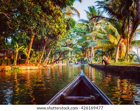 Vintage retro effect hipster style image of Kerala backwaters tourism travel in canoe. Kerala, India