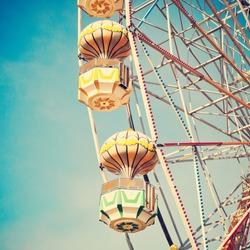 Vintage Retro Ferris Wheel on Blue Sky