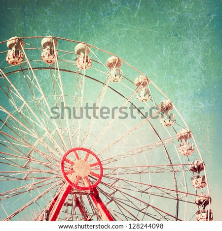 Vintage Retro Ferris Wheel on Blue Sky