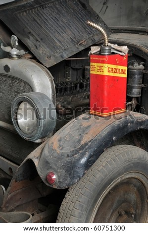 Vintage retro gas can isolated on old grunge car