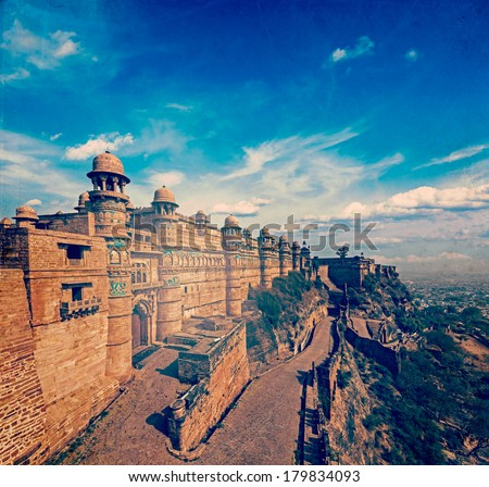Vintage retro hipster style travel image of India tourist attraction - Mughal architecture - Gwalior fort with overlaid grunge texture. Gwalior, Madhya Pradesh, India