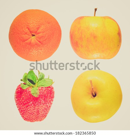 Vintage retro looking Apple orange and strawberry fruit - isolated over white background