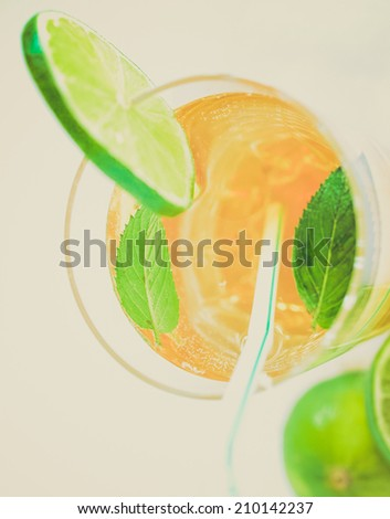 Vintage retro looking Cocktail mixed alcoholic drink with lime and peppermint
