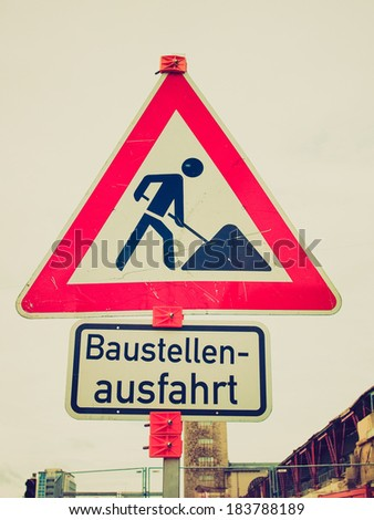 Vintage retro looking Road works sign for construction works in progress - in German