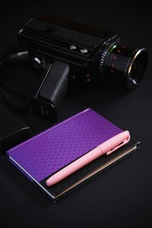 Vintage retro 8mm camera and notebook