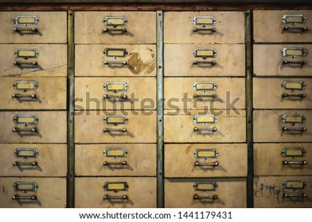 Vintage retro old chinese medicine  metal cabinet texture background. Drug drawer, drug shelf, vintage drawer, Chinese herbal medicine storage. #1441179431