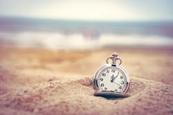 Vintage,retro  pocket watch on the beach