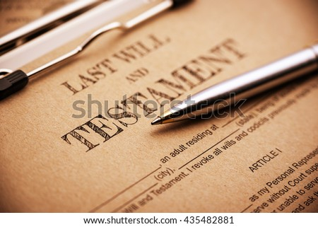 Vintage / retro style : Blue ballpoint pen and a last will and testament on a clip board. A form is printed on a light brown mulberry paper and waiting to be filled and signed by testator / testatrix. Foto stock ©