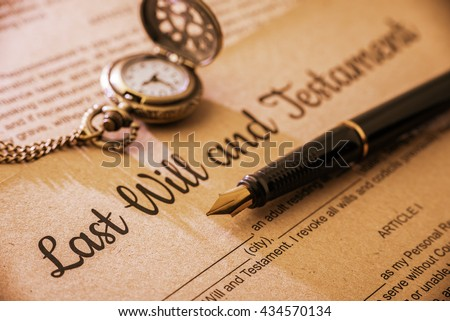 Vintage / retro style with a long shadow : Fountain pen, a pocket watch on a last will and testament. A form is printed on a mulberry paper and waiting to be filled and signed by testator / testatrix. Foto stock ©