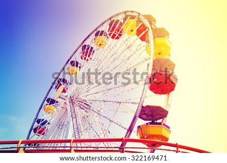 Vintage retro toned picture of an amusement park.