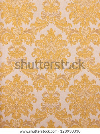 vintage retro wallpaper background with a pattern of flowers and branches