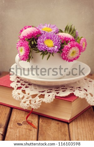 Vintage romantic still life with flowers and book